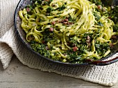 Green kale pasta with diced ham