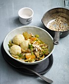 Potato dumplings with pork, apricots and grapes