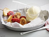 Grilled fruit skewers with vanilla ice cream