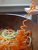 Carrot spirals being cut with a spiral cutter
