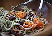 Raw vegetable salad made of vegetable strips and spirals (close-up)