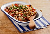 Spicy cannellini bean salad with cherry tomatoes and chorizo (Portugal)