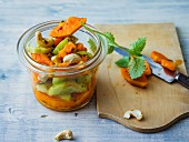 Papaya and cucumber salad with cashew nuts and lemon balm