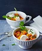 A colourful lentil salad with red peppers, mango and goat's cream cheese