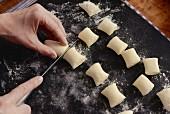 Gnocchi being portioned