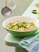 Kohlrabi and pea soup with sausage