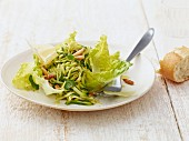 Raw courgette salad with pine nuts
