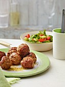 Meatballs with a colourful salad