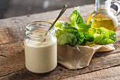 Caesar dressing made from egg yolk, garlic, lemon juice and Worcestershire sauce