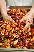 Dried fruits being mixed for spiced bread, Pain d'Épices de Mireille, Easter, Strasbourg