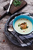 Cream of parsnip soup with crispy parsnip crisps