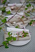 Apple blossom, cutlery and names on paper scrolls
