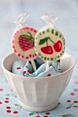 Cherry lollies in a bowl with a napkin