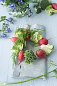 A broccoli and radish wreath