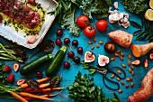 An arrangement of vegetables, fruit, almonds, herbs and lamb