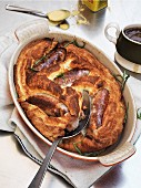 Toad in the hole with gravy and mustard (England)