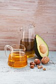 An arrangement of vegetable oils, avocados and nuts