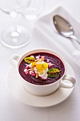 Beetroot purée with goat's cream cheese and pine nuts