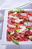 Carpaccio (slices of raw beef with capers and Parmesan cheese, Italy)