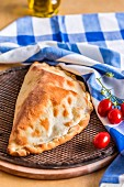 Calzone caprese (pizza pocket with tomatoes and mozzarella, Italy)