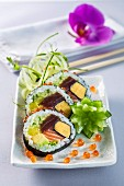 Futomaki sushi with omelette, tuna, salmon, avocado and cucumber