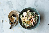 Brussels sprouts and carrot salad with flaked almonds