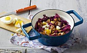 Red cabbage and ham stew with sunflower seeds