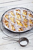 Linz apple tart with icing sugar