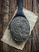 Chia seeds on a wooden spoon