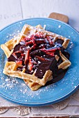 Waffles with chocolate sauce and strawberries