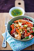 Prawn salad with quinoa, cucumber, tomatoes and radicchio