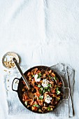 Aubergine and tomato ragout wit capers and red onions
