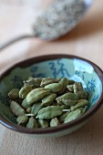 Green cardamom in a ceramic bowl