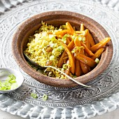 Fried almond rice with sultanas and sweet carrots