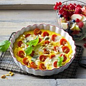 Onion and polenta quiche with cherry tomatoes and Gorgonzola