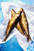 Smoked kippers on a piece of paper