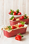 Mini strawberry and quark ckaes in polka dot baking tins
