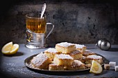 Сoconut cakes with tea and lemon wedges