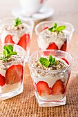 Strawberries with whipped cream and mint leaves
