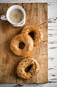 Bagels and coffee on a chopping board