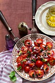 A cherry tomatoes, red onion and basil salad