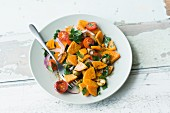 Warm sweet potato salad with cherry tomatoes, green olives and almonds