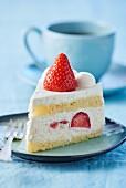 A slice of strawberry cream cake