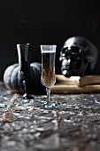 A Black Tooth cocktail made with Guinness, champagne and sambuca