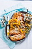 Smoked side of salmon with an orange and caper sauce and dill for Christmas dinner