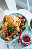 Roast turkey with caramelised onions, walnuts and dumplings for Christmas dinner