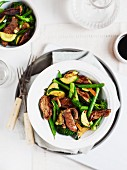Steamed vegetables with beef strips