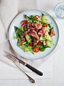 A colourful salad with lamb fillet strips