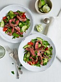 Thai beef salad; a colourful salad with fried, pink beef fillet strips