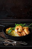 Spicy prawns with cauliflower cake with flax seeds and coriander
